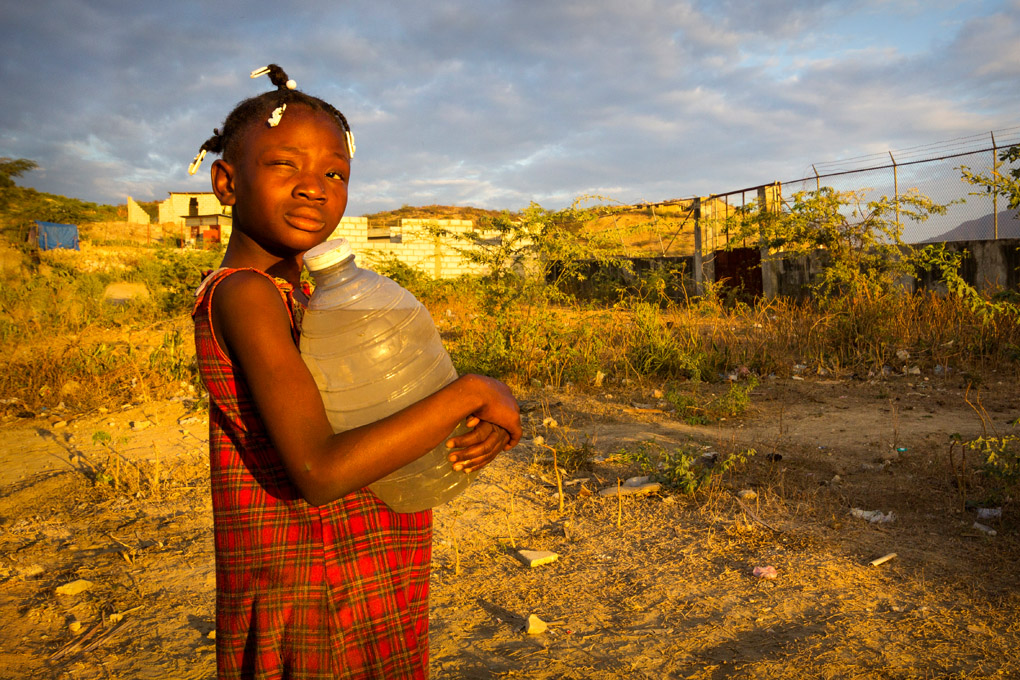 Fetching clean water - Duclos Community, Haiti